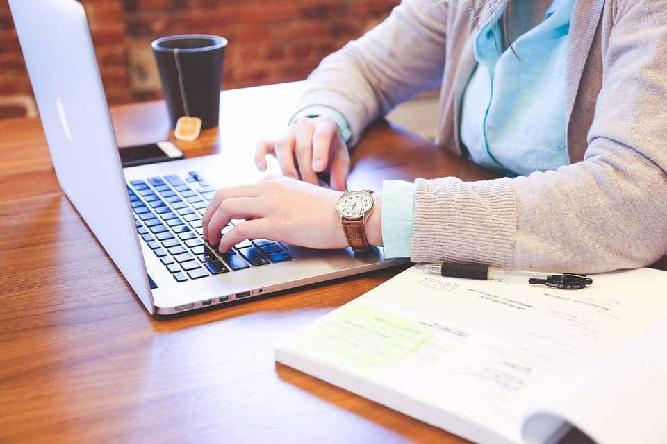Woman Writing Email To Turn Down A Job Offer